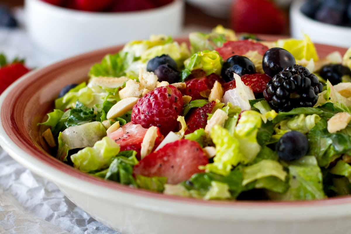 Chopped Salad with Berries and Nuts in a Bowl