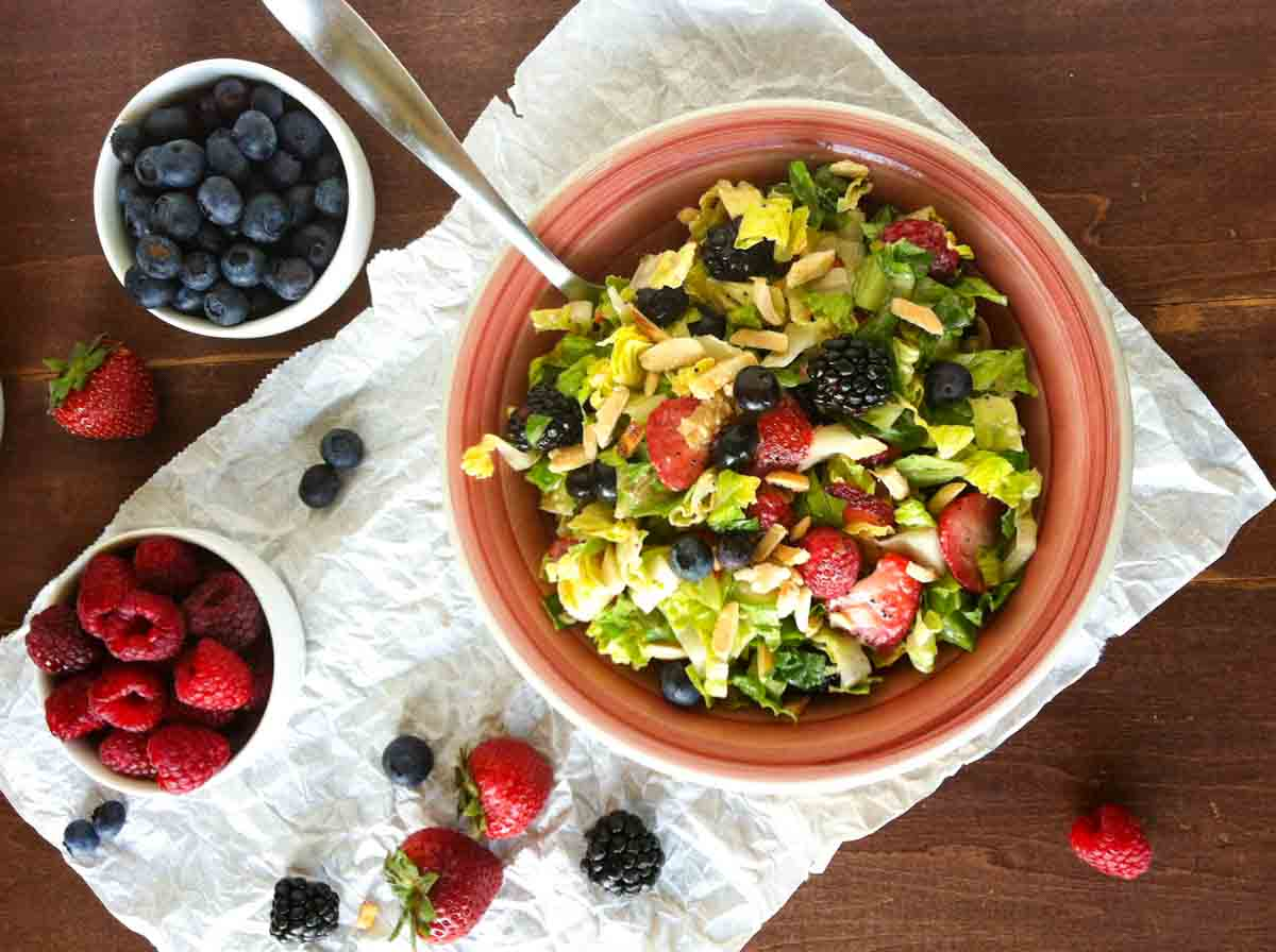 overhead view of summer chopped salad with berries