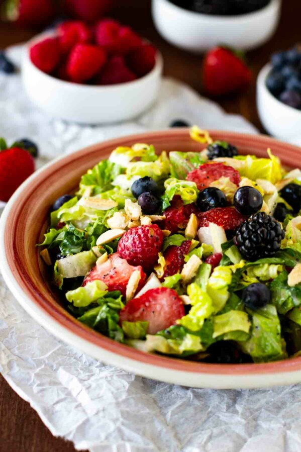 Chopped Salad with summer berries, nuts and homemade poppy seed dressing