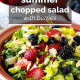 Chopped salad with berries and nuts with text overlay