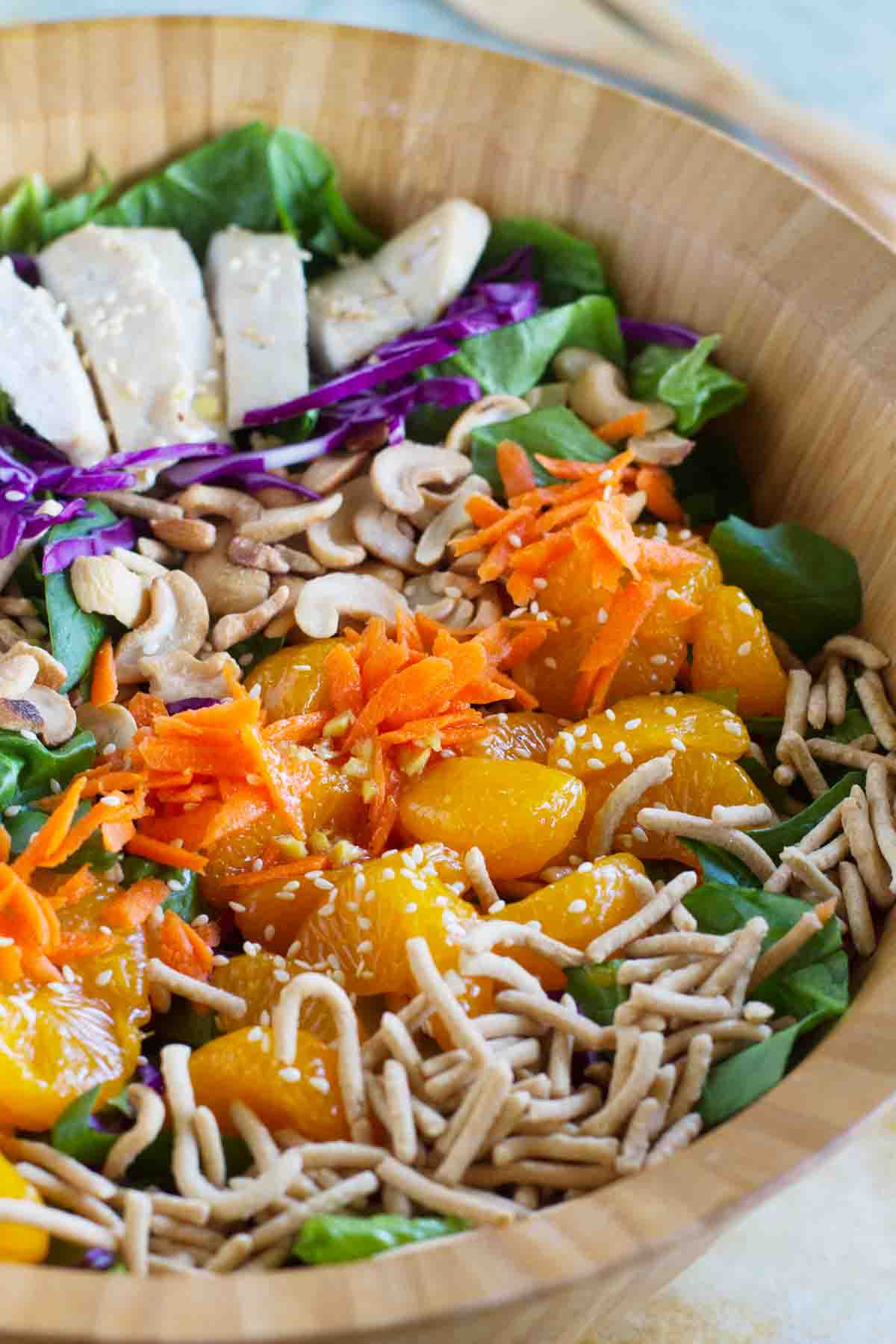 Asian Chicken Salad in a wooden bowl