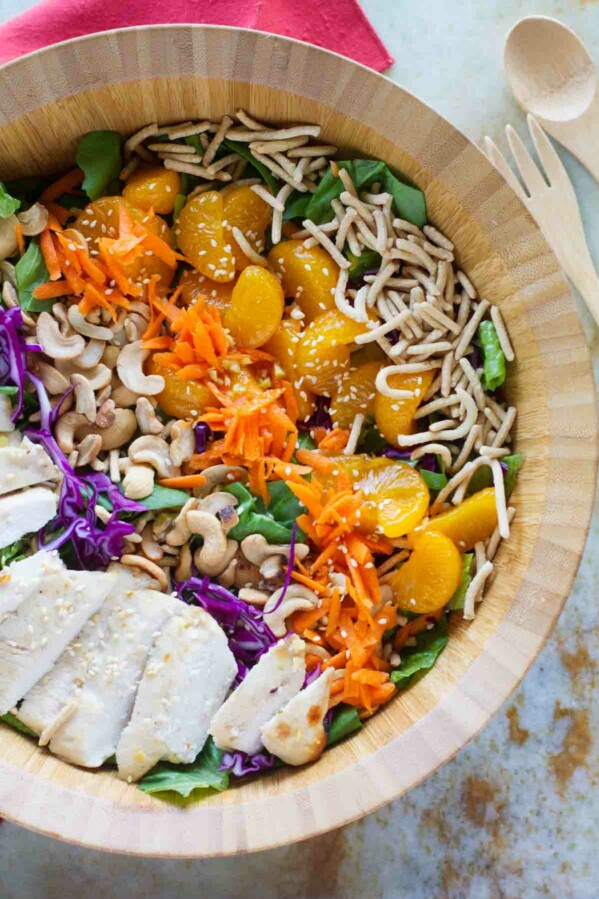 top view of salad with chicken, cashews, mandarin oranges, carrots, chow mein noodles and greens