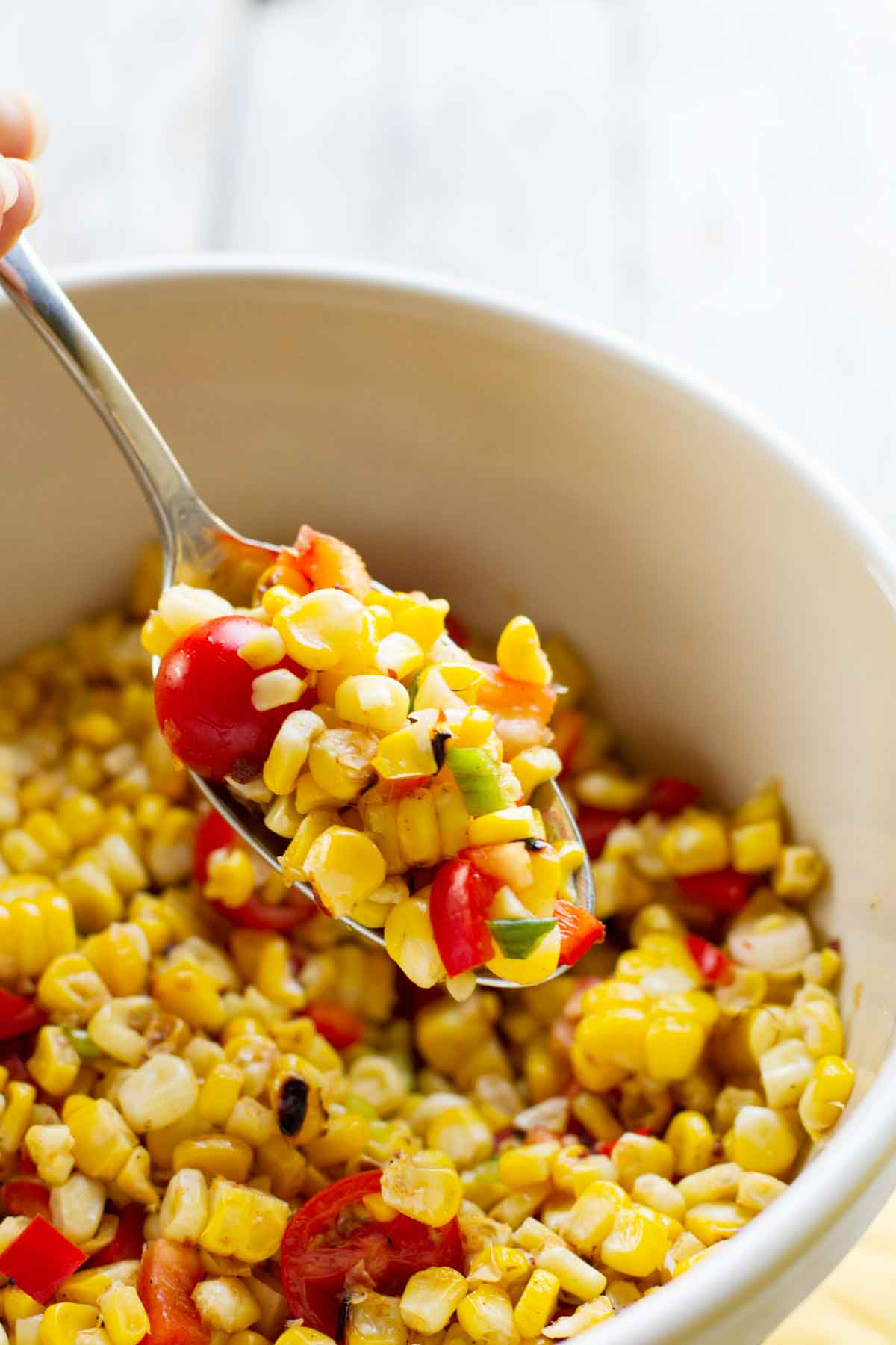 spoonful of grilled corn salad
