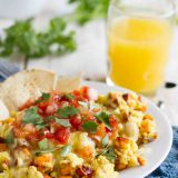 plate with scrambled eggs made with sweet potatoes and Mexican flavors