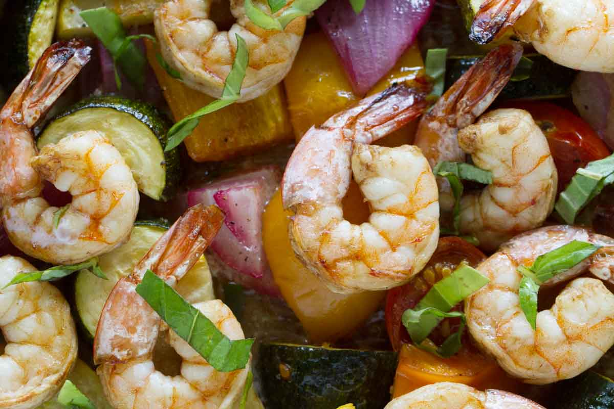 close up of cooked shrimp with chopped vegetables