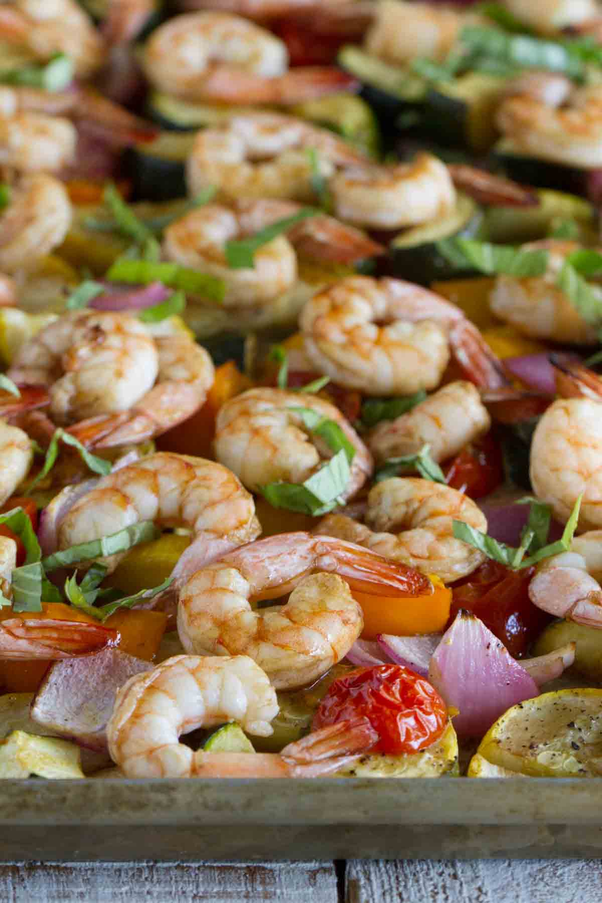 chopped vegetables and shrimp cooked on a sheet pan