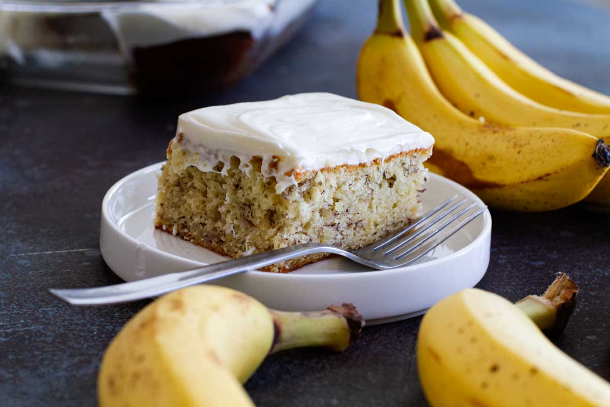 slice of banana cake on a plate with a fork