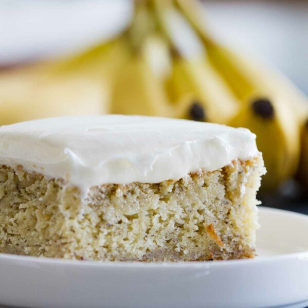 close up of banana cake with cream cheese frosting