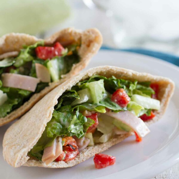 pita sandwich with turkey, lettuce and roasted red peppers