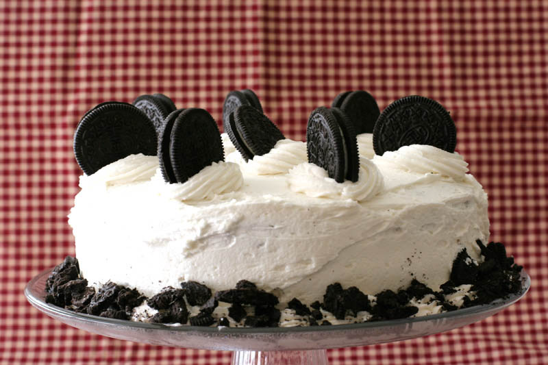 Cookies and Cream Cake with whole cookies on top with a red background
