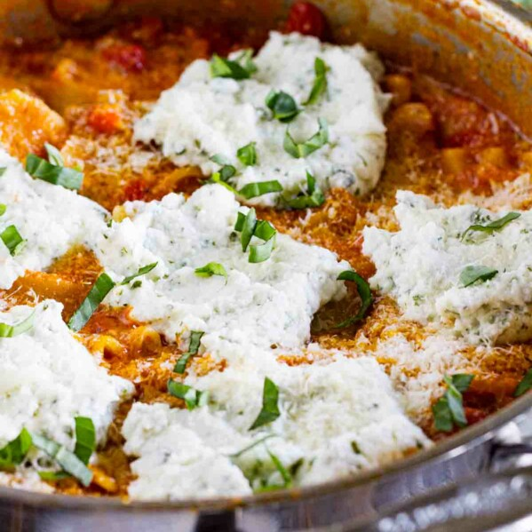 pan with Skillet Lasagna topped with ricotta and basil