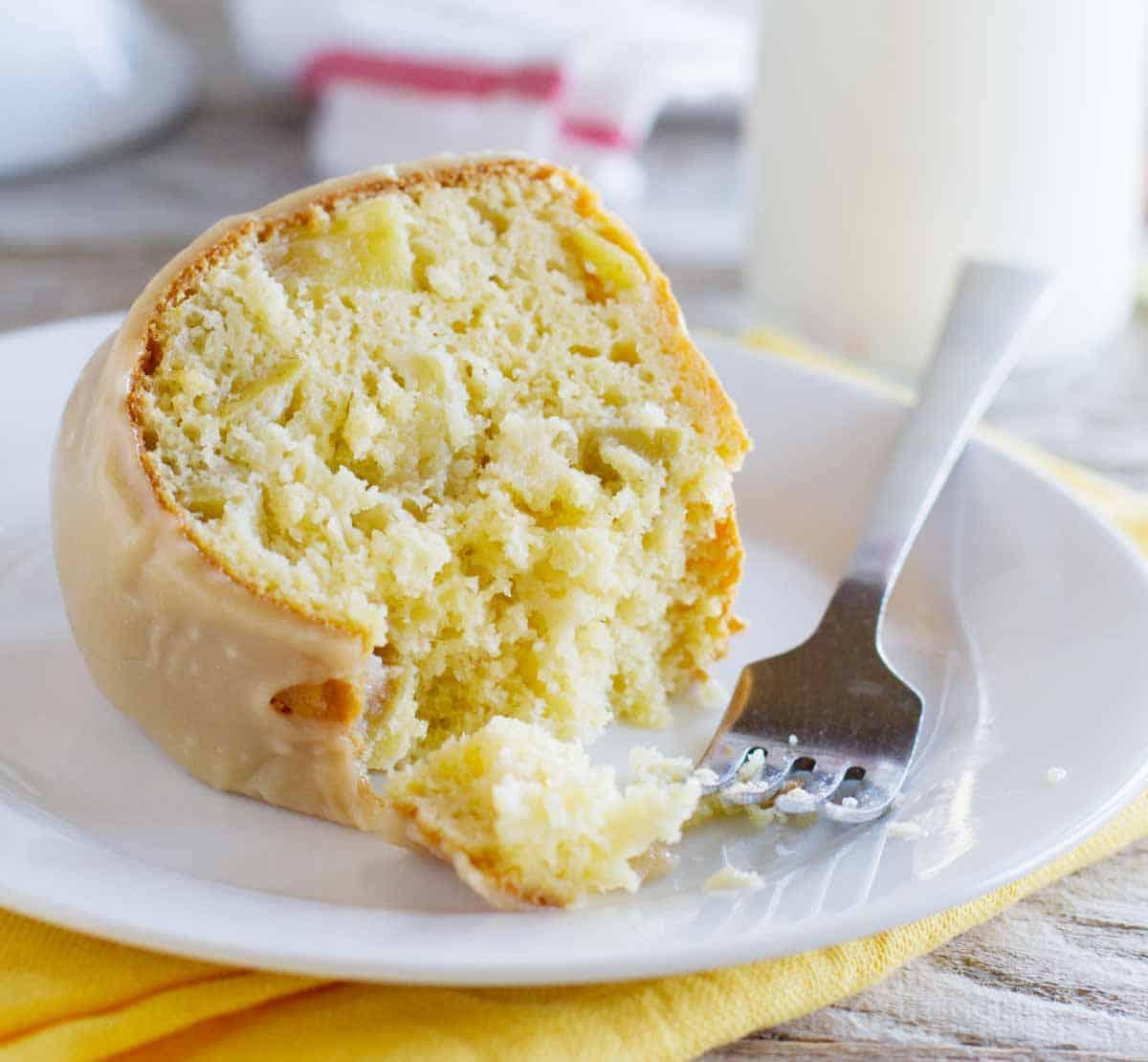 slice of apple bundt cake with a fork
