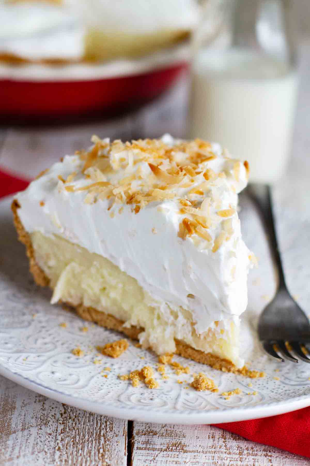 plate with slice of coconut cream pie