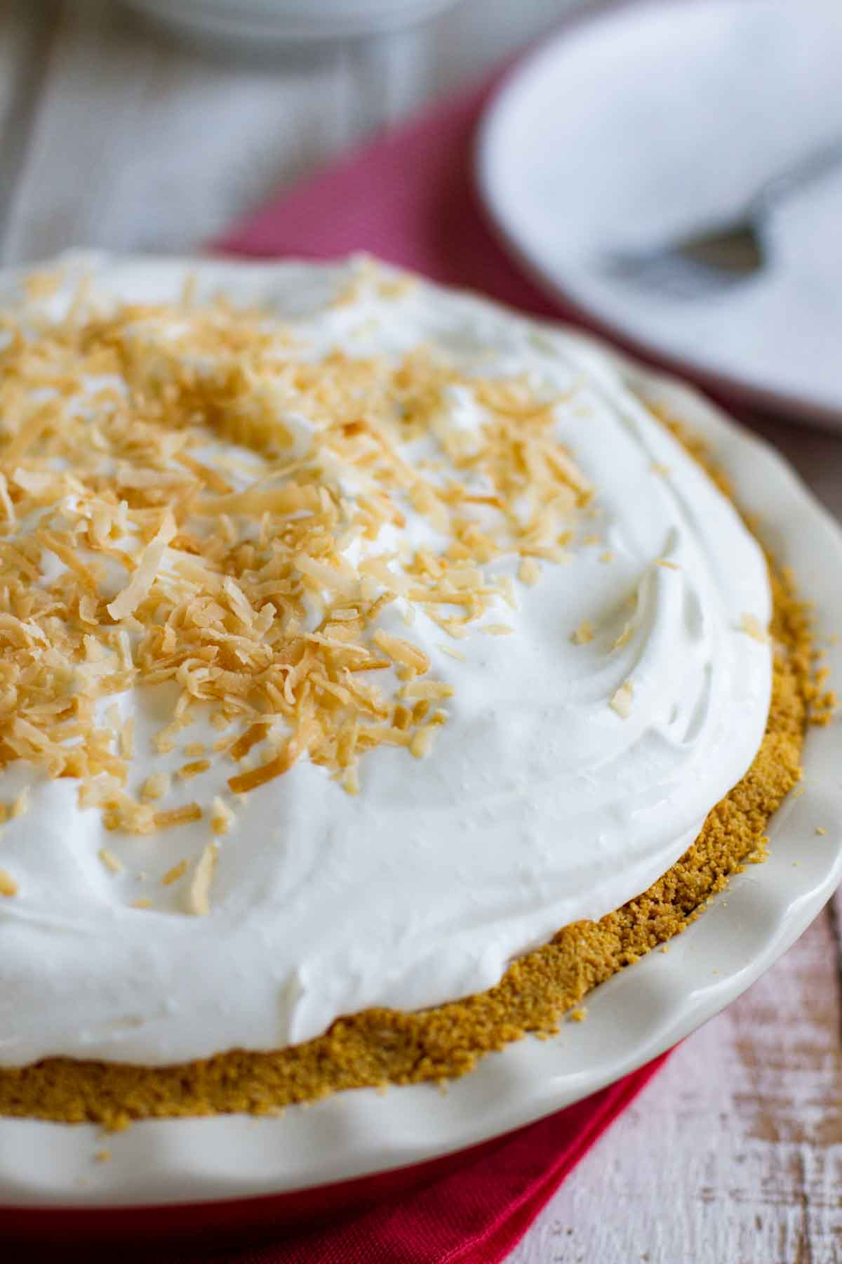 whole coconut cream pie with a cookie crust