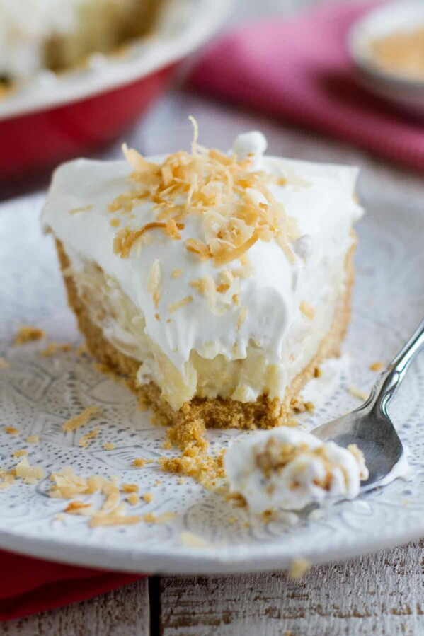 fork with bite of coconut cream pie