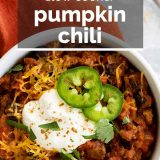 bowl of pumpkin chili with text overlay