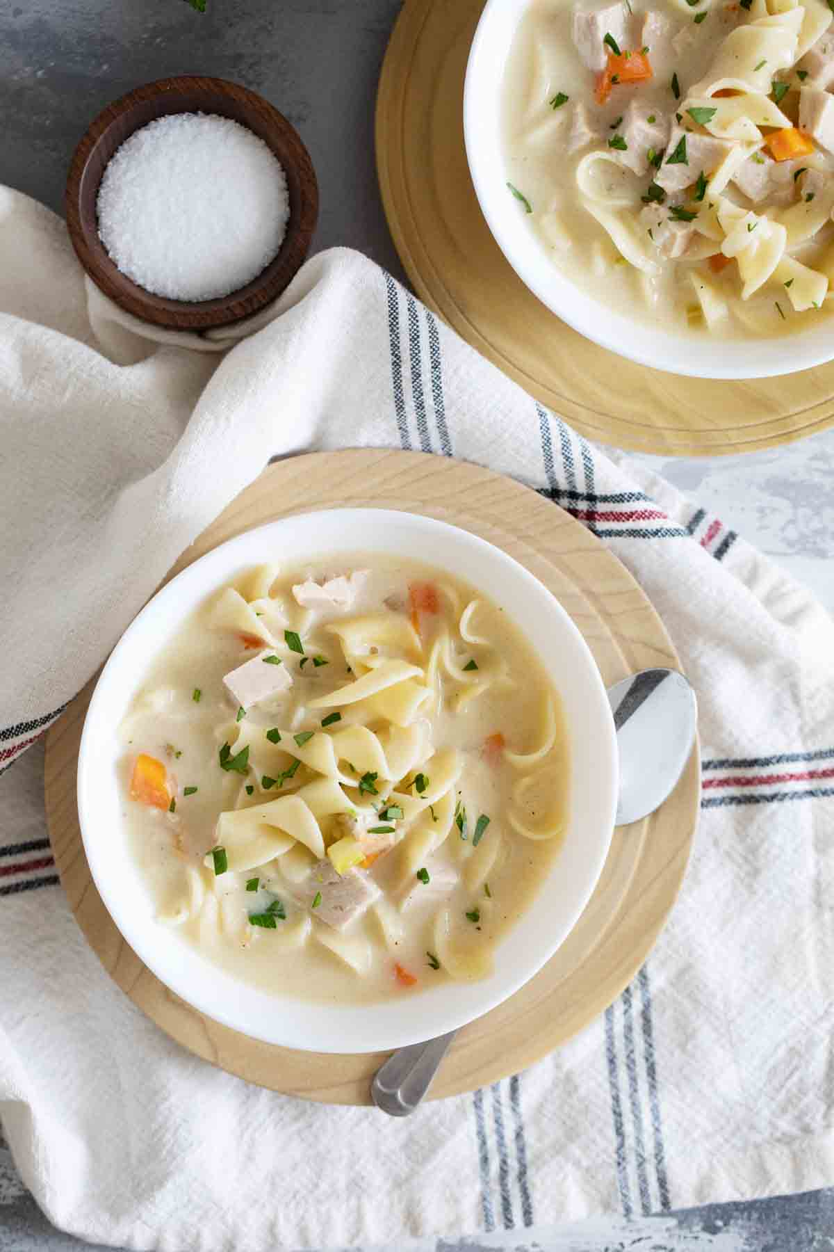 overhead view of Creamy Turkey Noodle Soup in bowls on plates