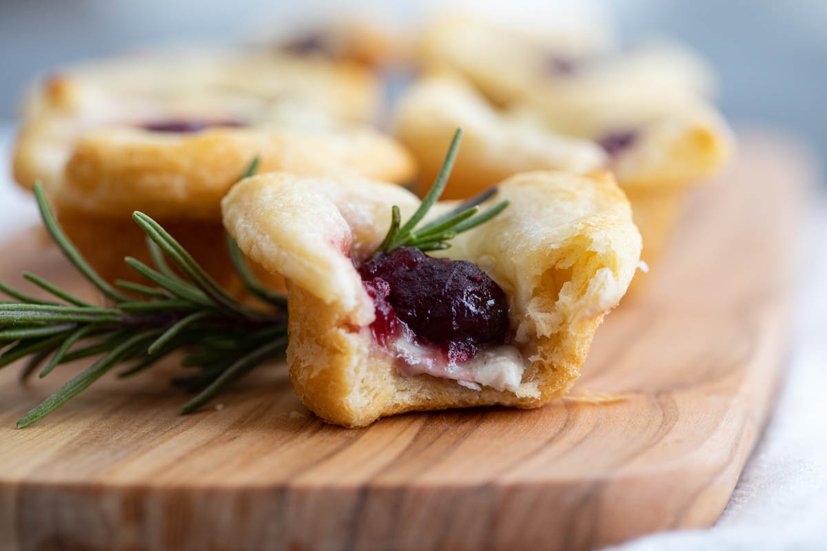 cranberry brie bites with bite taken from it