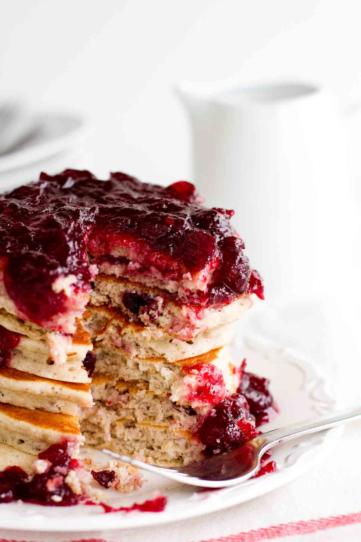 stacked Cranberry Pancakes with a bite taken out