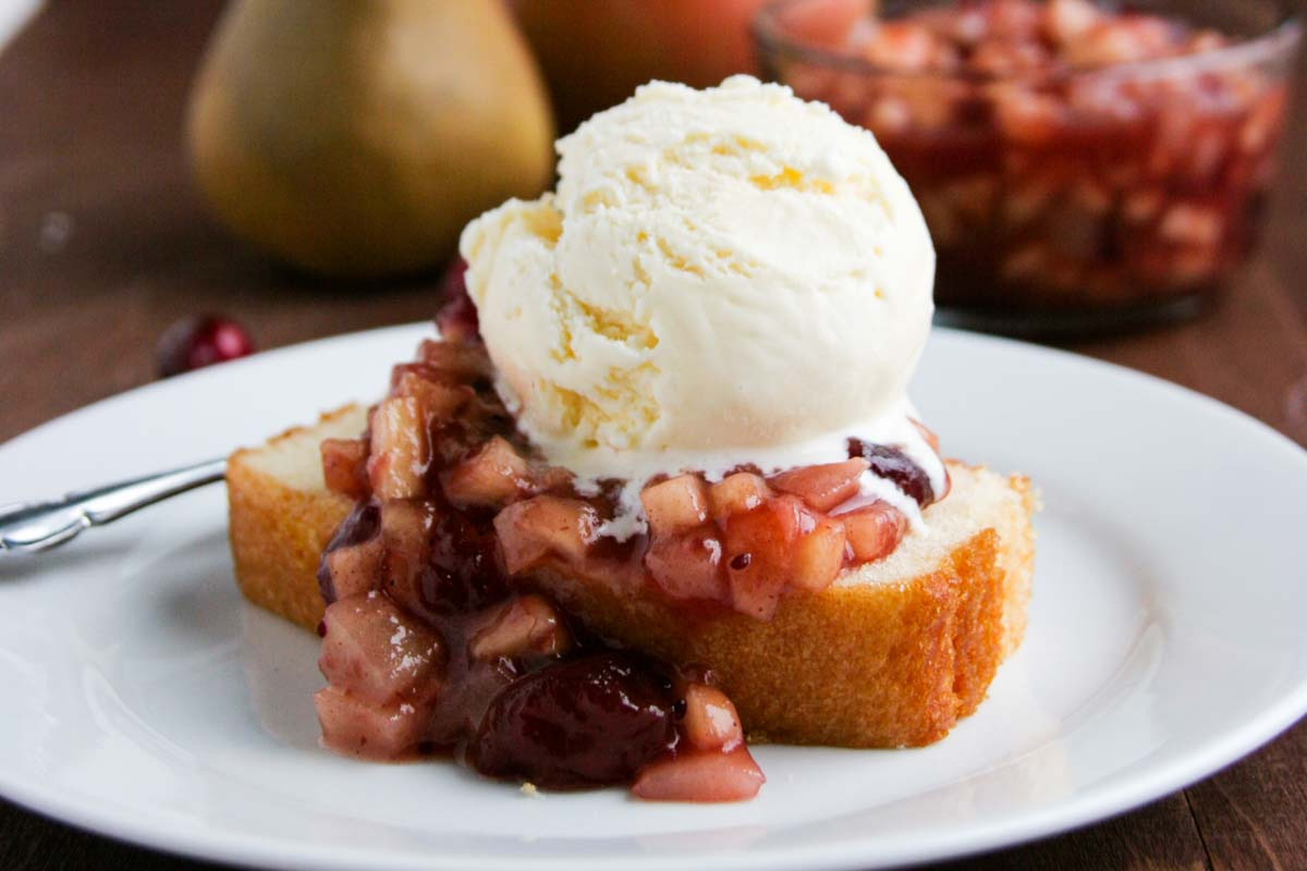 Cranberry Sauce over Pound Cake with ice cream on a plate