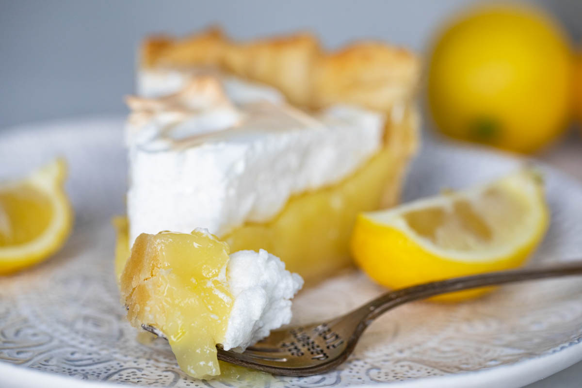 bite of lemon meringue pie on a fork