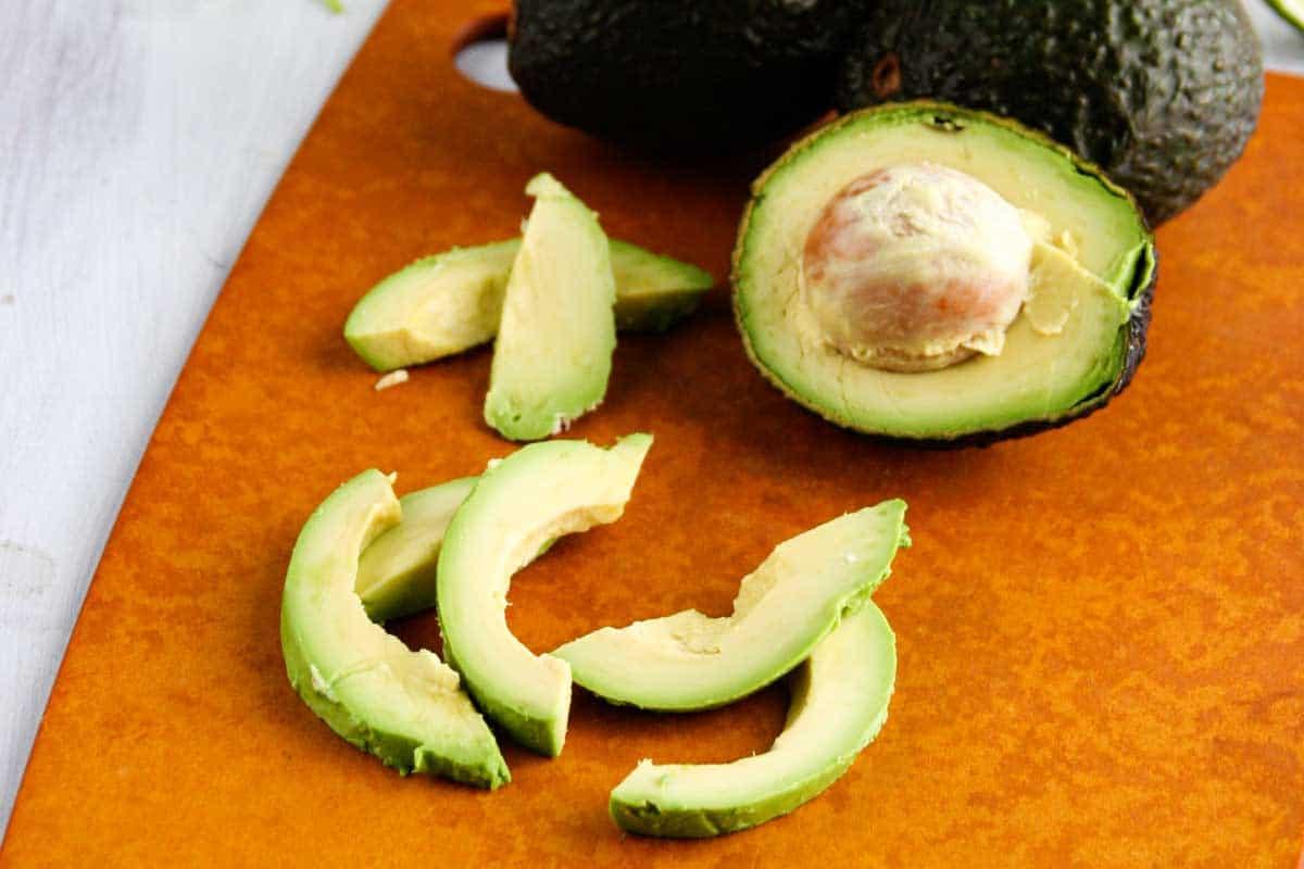 sliced avocado on a cutting board