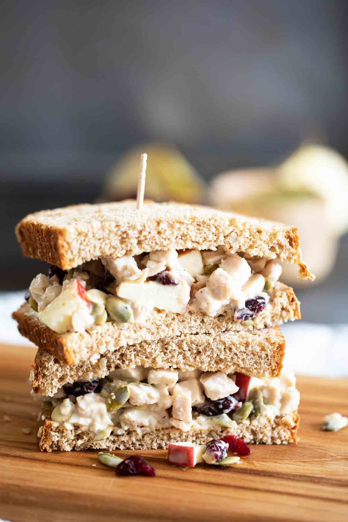 two half turkey salad sandwiches stacked on top of each other