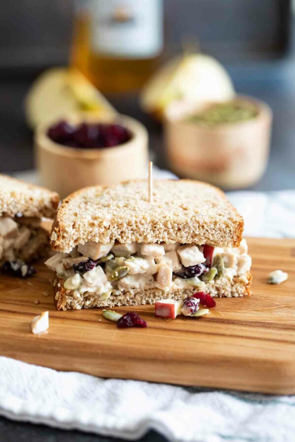 Turkey Salad Sandwich cut in half on a cutting board