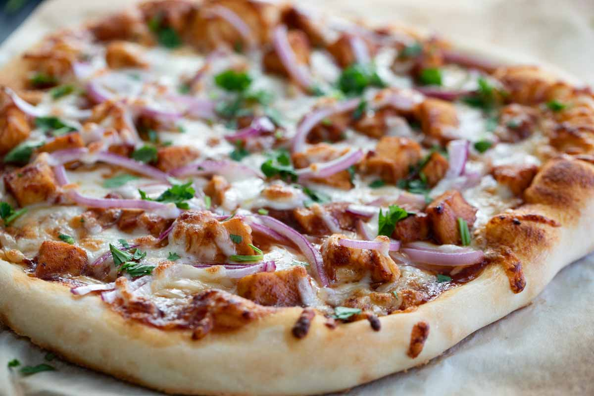 Copycat BBQ Chicken Pizza with onions and cilantro