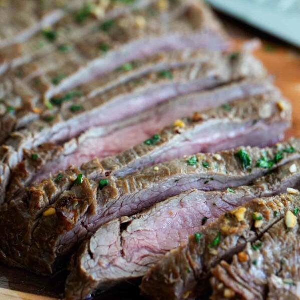 Marinate flank steak on a cutting board cut into slices