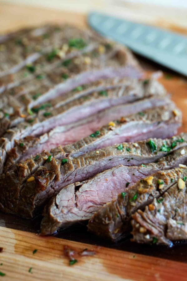 Marinate flank steak on a cutting board cut into slices