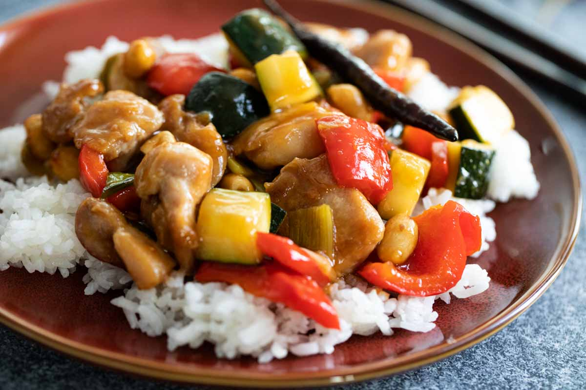 plate of kung pao chicken on rice