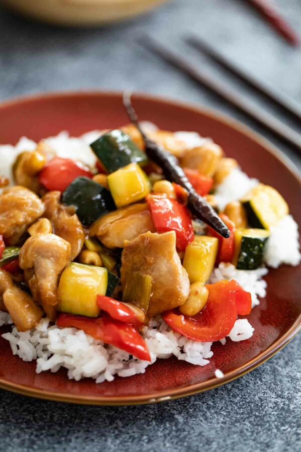 Kung Pao Chicken on a brown plate with rice