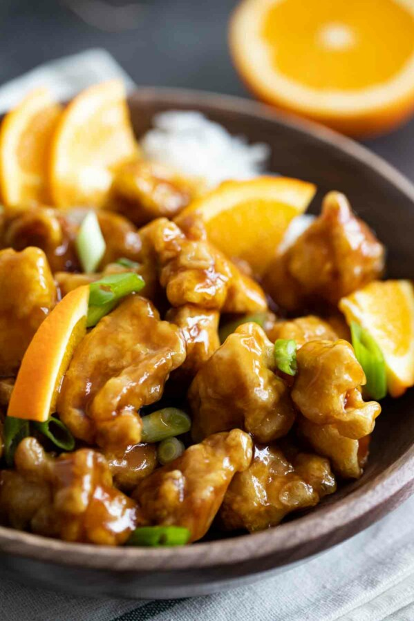 bowl of homemade orange chicken with green onions