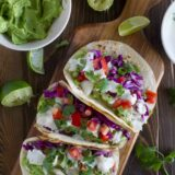overhead view of 3 Baja Fish Tacos on a cutting board
