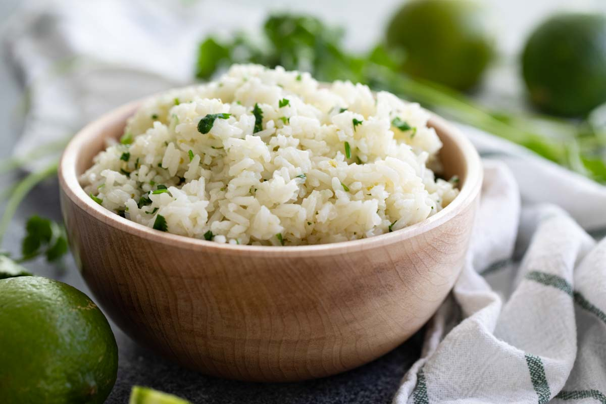 bowl of cilantro lime rice in a wooden bowl