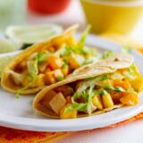 2 Citrus Fish Tacos on a plate with lime slices