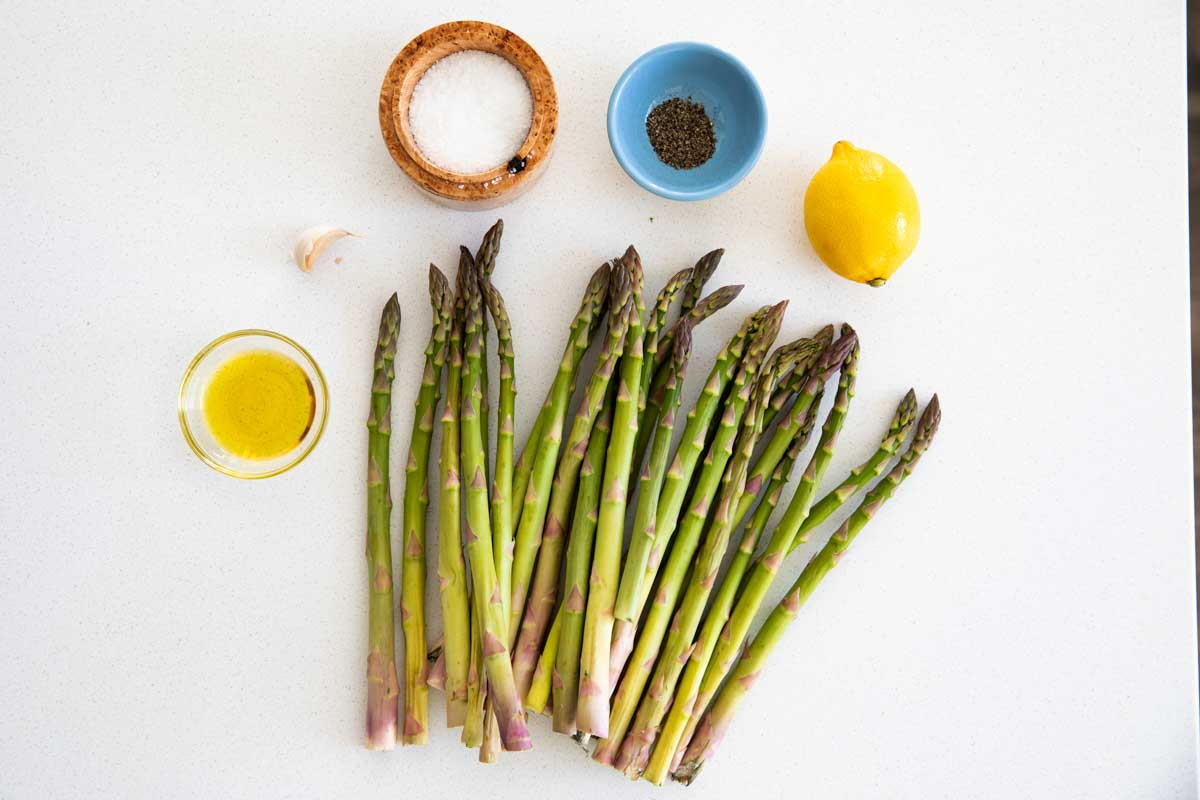 flat lay of ingredients needed for roasted asparagus