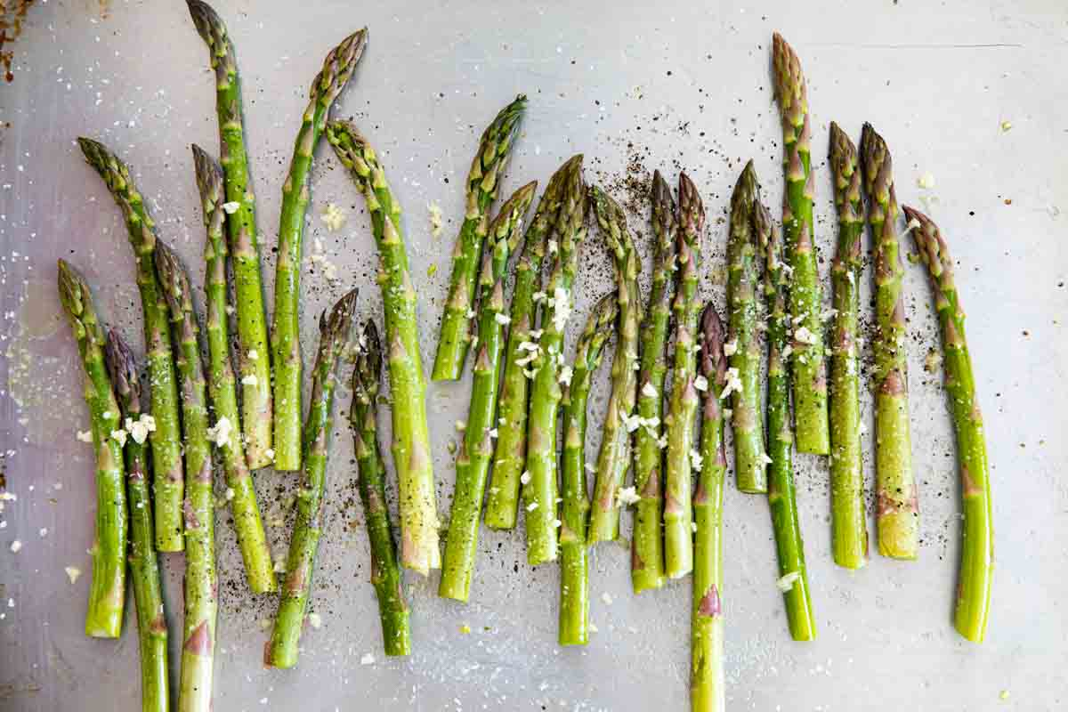 asparagus with garlic on a baking sheet