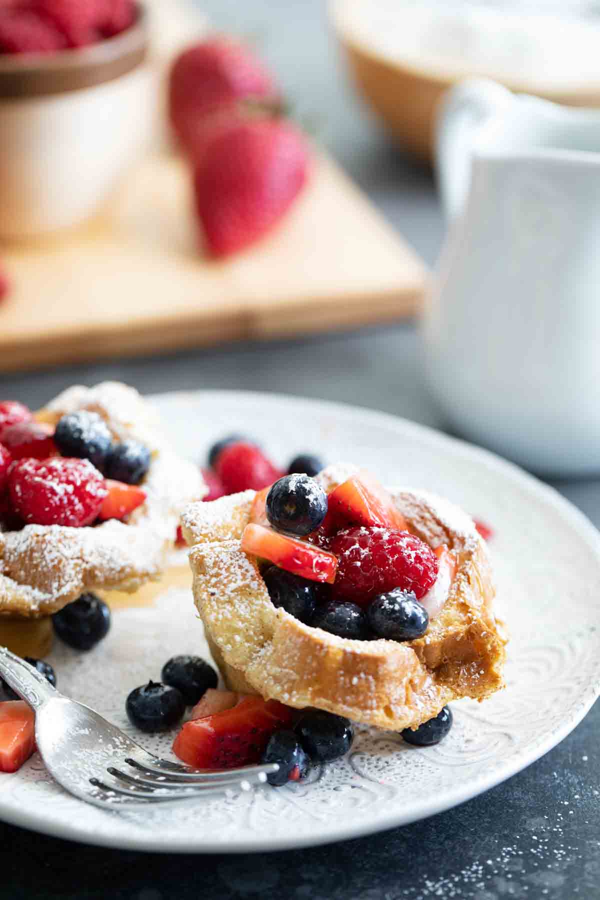 French Toast Cups filled with fresh berries on a plate