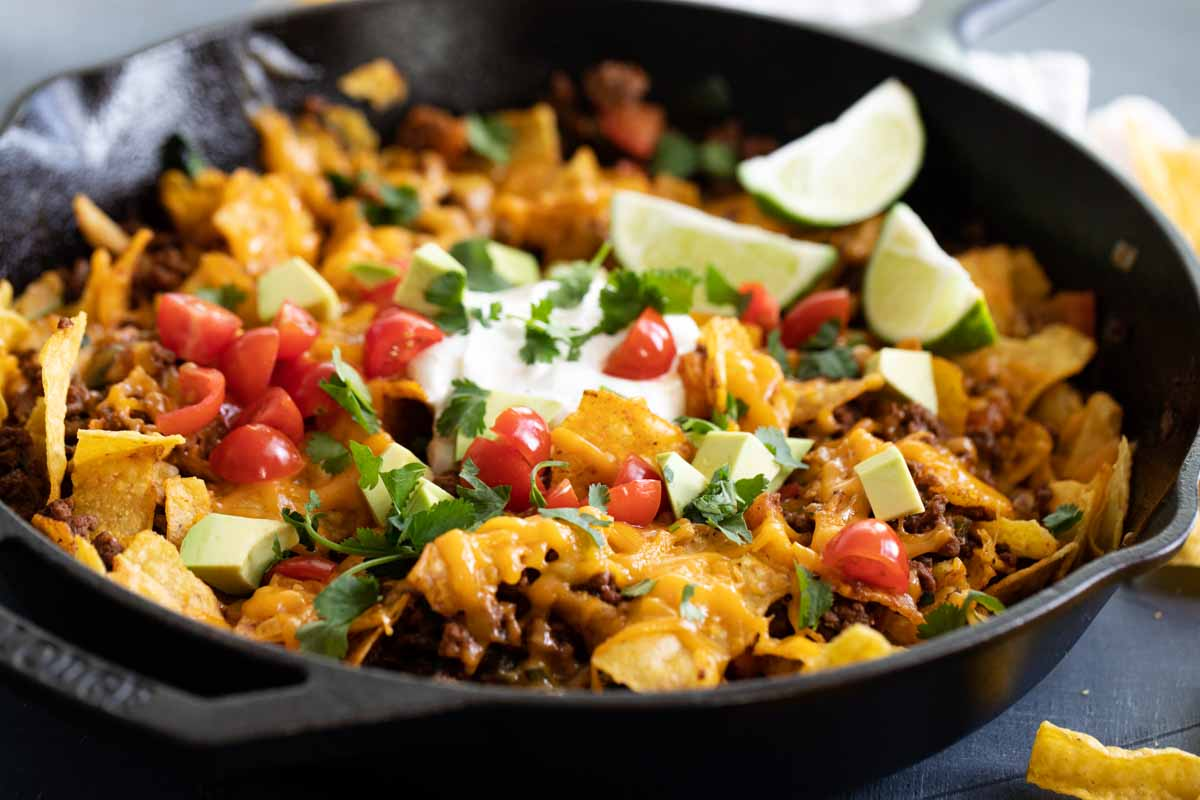 taco skillet in a cast iron skillet with toppings