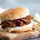 bbq beef sandwich on a wooden board