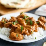 Butter Chicken over rice on a plate