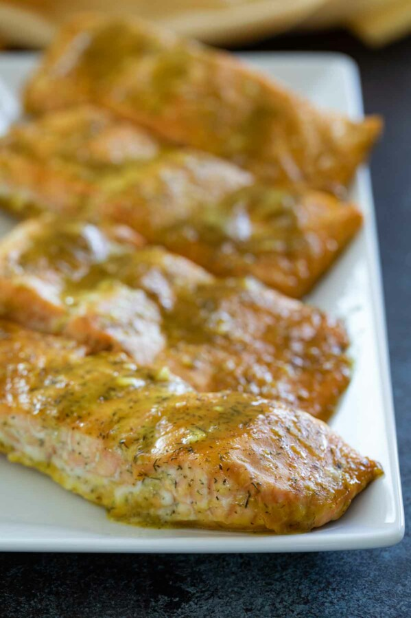 fillets of salmon with honey mustard sauce over the top