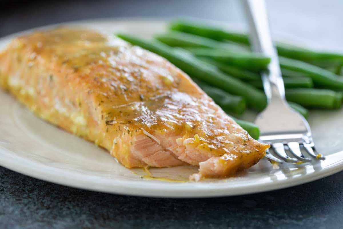 honey mustard salmon filet with bite taken to show texture