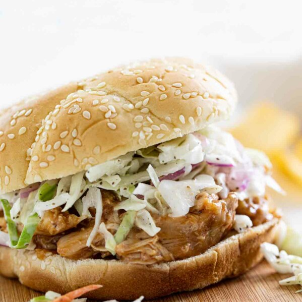 Slow Cooker Teriyaki Chicken Sandwich on a cutting board