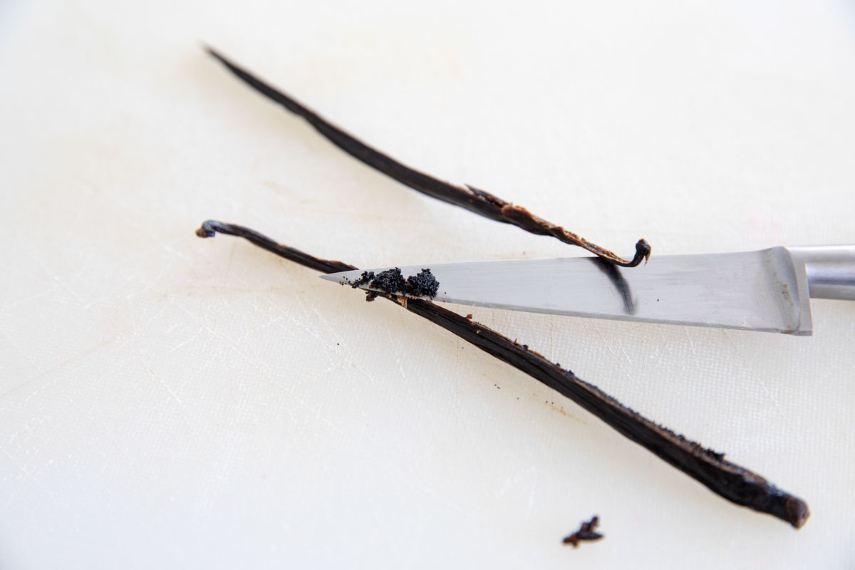 scraping the beans from a vanilla bean