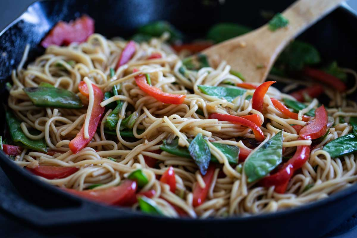 skillet with Chinese noodles and vegetables