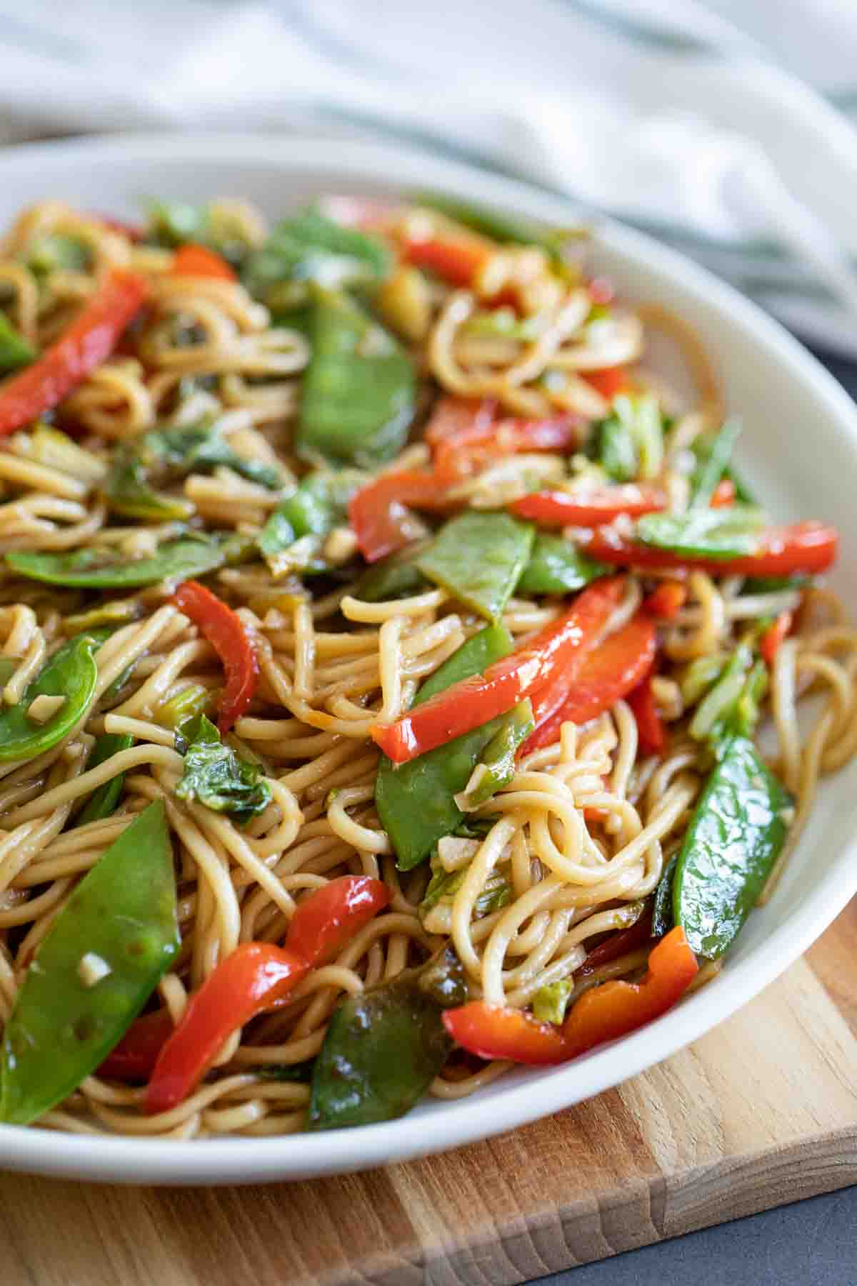 dish with lo mein noodles with cabbage, peas and peppers