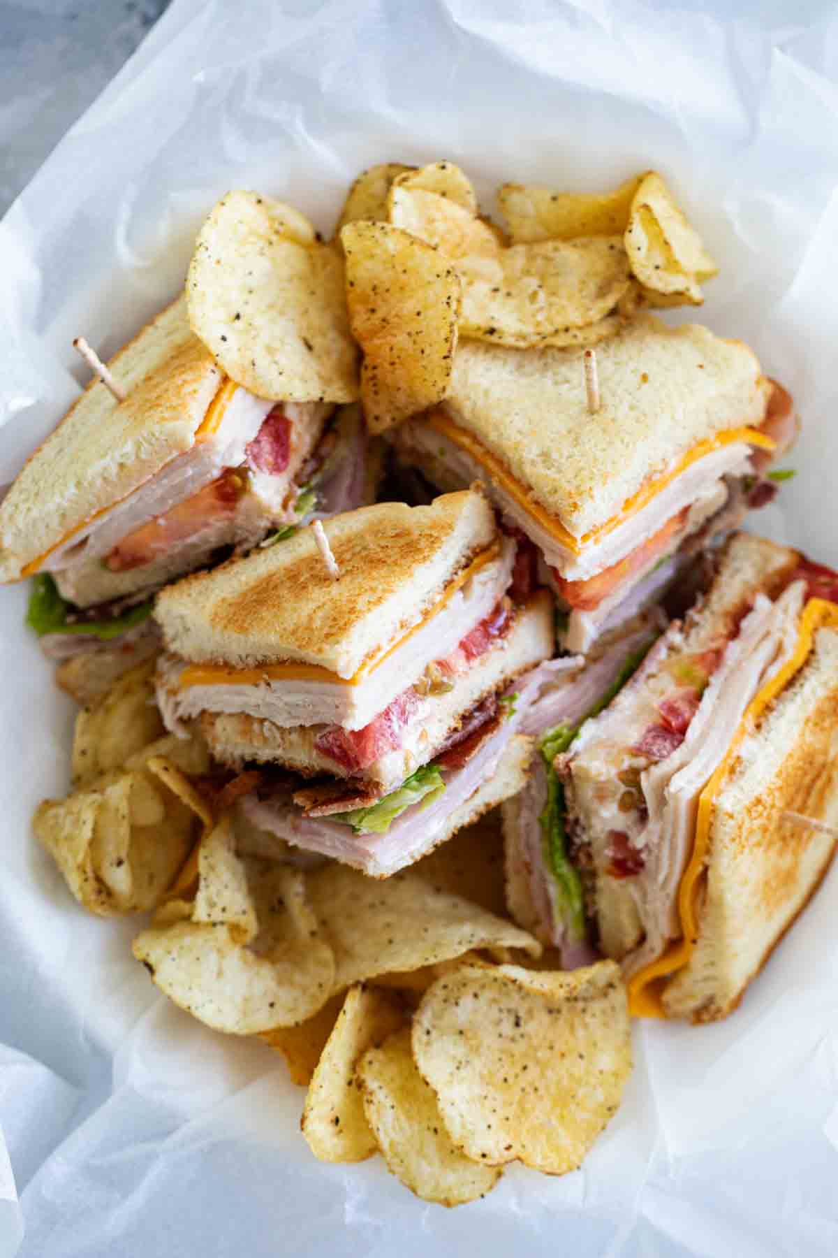 overhead view of cut up club sandwich in a basket